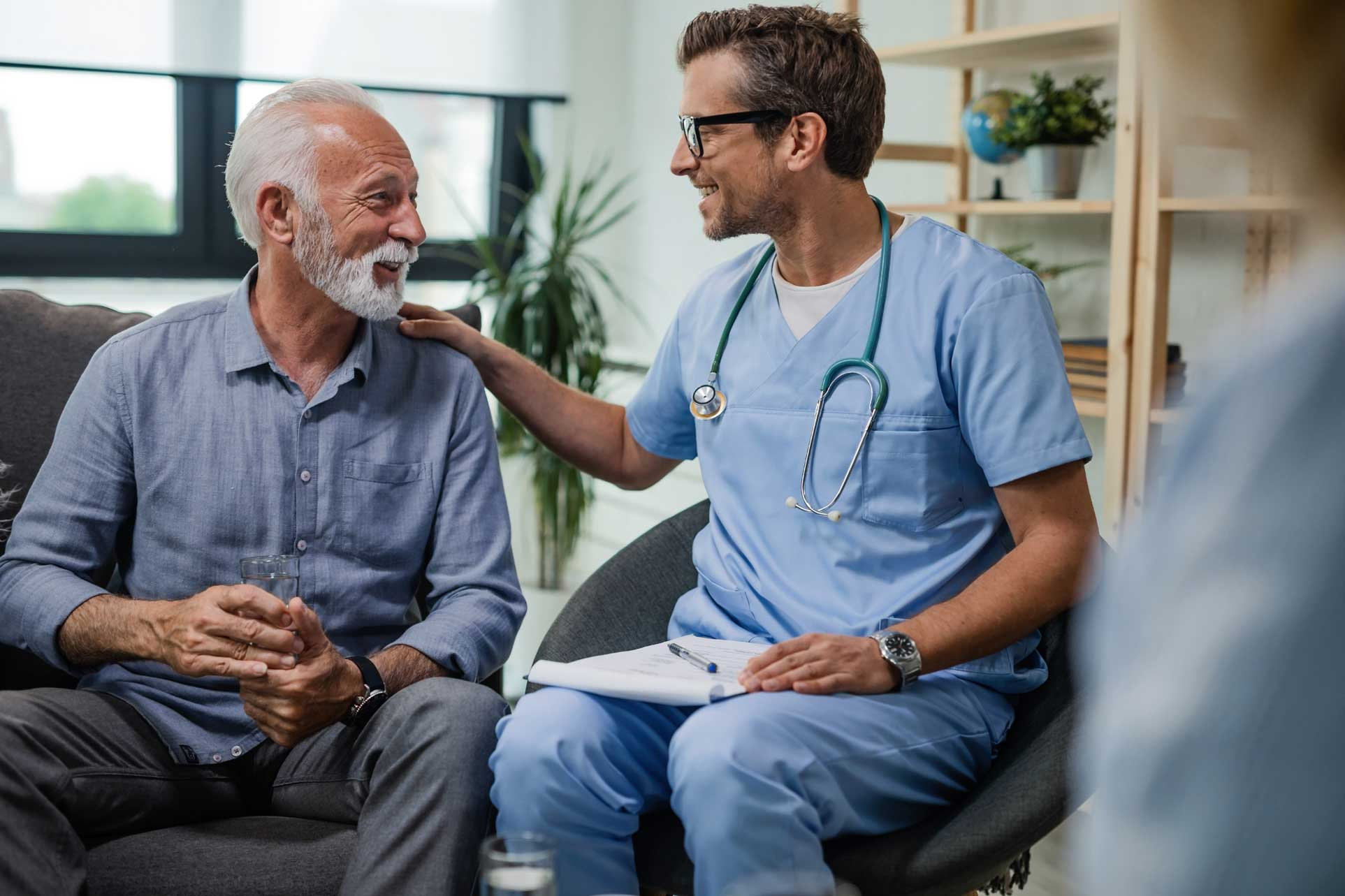 Male patient talking with male doctor.